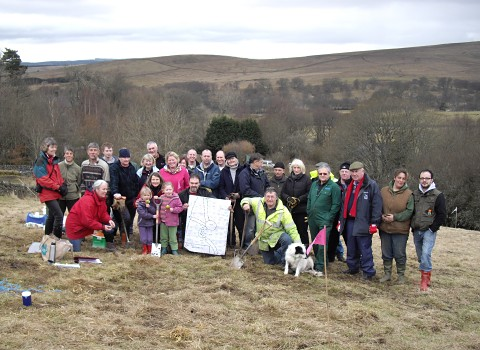 Members of Parish Council, the community and from the Northumberland National Park Authority at the end of the successful planting day