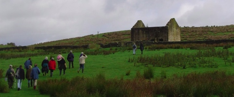 TAG members heading up the hill to Black Middens Bastle House