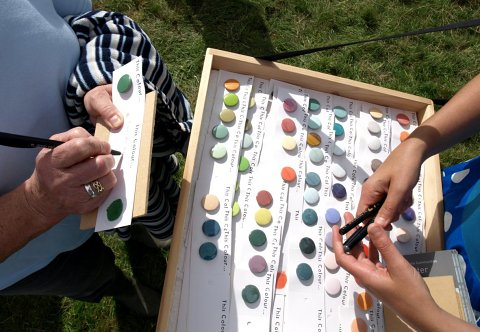 Imi Maufe, interactive performance about colour association at Falstone Show using locally made Unison Colour's handmade artist's pastels in an unconventional way, 2008. Maufe created an artist's book from the material collected