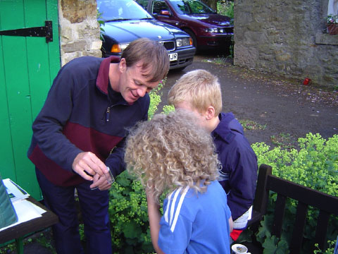 NNPA ranger, Shaun Hackett, showing moths to young enthusiasts